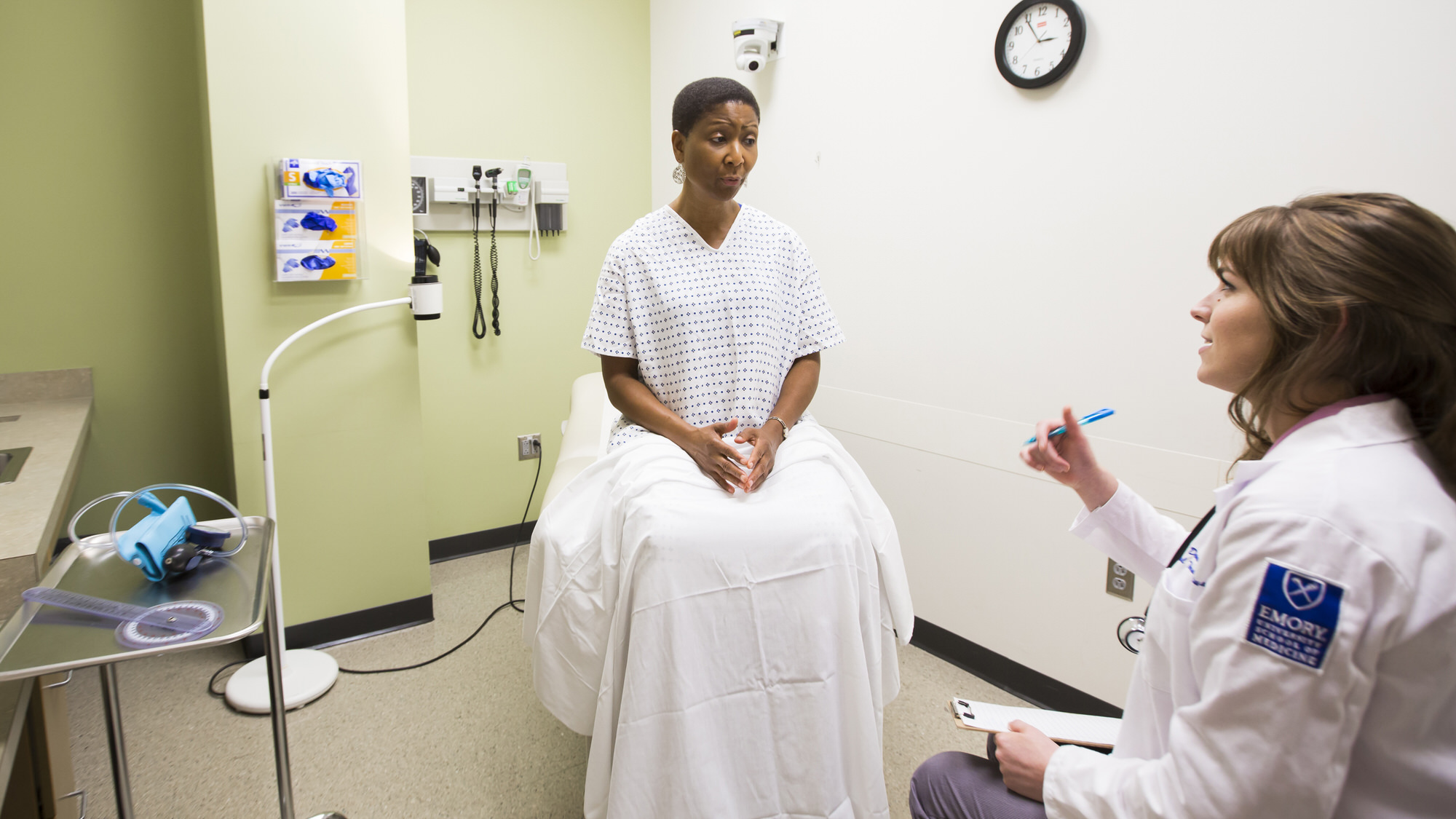 Student talking to a patient